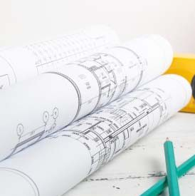 safety-helmet-construction-level-pencils-blueprints_113913-624